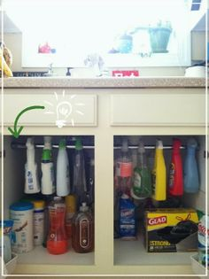 Curtain rod under sink for organized cleaning storage