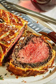 Wrapped in golden, buttery puff pastry and filled with deeply savory mushroom duxelles, beef Wellington is an unforgettable centerpiece to any feast. #dinner #chicken #chickendinner #chickenrecipes
