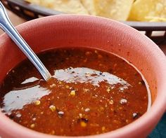 Salsa roja, a simple yet flavorful Salvadoran cooked tomato sauce, is often served alongside pupusas and curtido.
