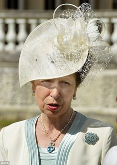 dailymail:  Queen's Garden Party, June 10, 2014-Princess Anne chose a cream jacket with eau-de-nil lapels and a matching dress