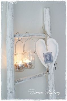I love this!! Painted Wooden Ladder made to look rustic with the lighted jars!! Perfect