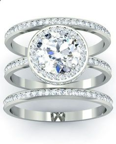 Bridal Three Piece Wedding Set...would be even better if the engagement ring was three stones