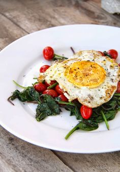 Delicious and Healthy Breakfast. Wilted greens, sauteed tomatoes, and fried egg. Yum!