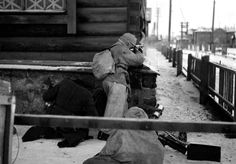 Finnish soldiers engage in a street battle with Soviet forces during the Finnish-Soviet Continuation War over contested territory in Karelia. Medvezhyegorsk (Finnish: Karhumäki), Medvezhyegorsky District, Republic of Karelia, Soviet Union. December 1941.