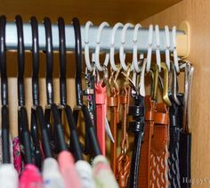 s 16 brilliant ways to squeeze much more into your closet, closet, organizing, storage ideas, Hang belts using shower curtain rings