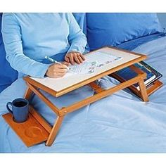 Lap table with cup holder - always a plus :p I like the grooves down the center that make it adjustable and versatile.