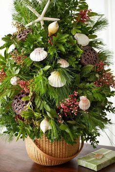 Island christmas decor | Baskets make pretty cache pots not just for flowers! Via Petal Talk .