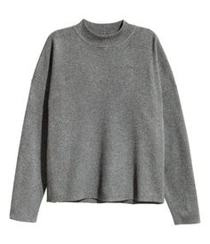 Black. Fine-knit sweater in a cotton blend with a ribbed mock turtleneck and dropped shoulders.