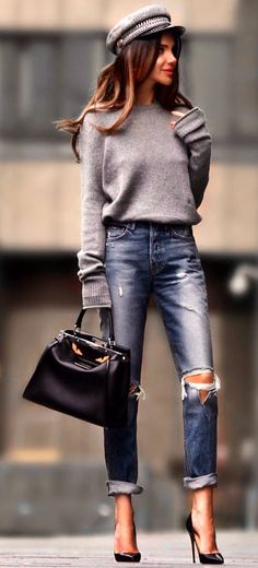 #spring #outfits  shallow depth of field photo of woman wearing gray sweater carrying black leather handbag. Pic by @zara__europe