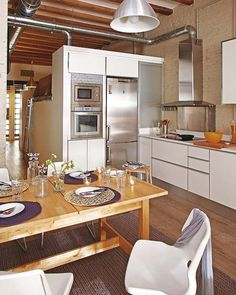 Note to self: great design idea for my own kitchen - the way the refrigerator, oven, stove and appliance garage are arranged with storage built around it.