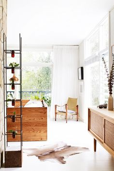 Living with with Mid-century console, campaign chair, and modern industrial planter.