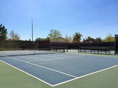 Side by side view of the two tennis courts at McCune Park in Eastvale, California. http://youreastvalerealtor.com/eastvale-parks/