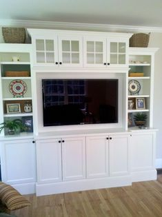 - built-in entertainment center. Great website with ideas for every room - windows in cabinets.