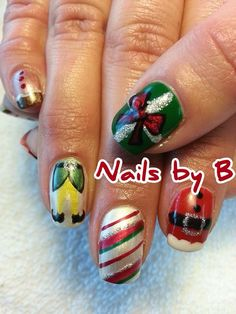 "Elf inspired Christmas nails certainly made me jolly!    Buddy said it best, ""The best way to spread Christmas Cheer, is singing loud for all to hear!""  And...call Brandy for some amazingly cheerful nails all year round!  Merry Christmas!!!  @Brandy Nelson"