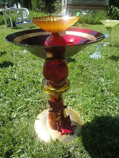 This is a birdbath I made from reclaimed glass vases, plates, bowls and an ashtray, glued together with epoxy.