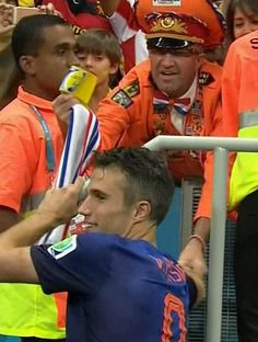 Robin Van Persie Give Captain Armband to Dedicated Netherlands Fan BRAZIL WORLD CUP JULY 12, 2014
