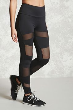 A pair of athletic stretch-knit leggings featuring mesh panels in front and an elasticized back.