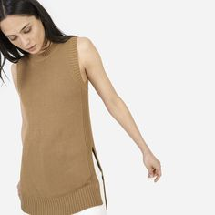 An elongated sleeveless sweater made in a substantial yet breathable knit. Wear it solo or layered. 55% cotton, 45% viscose Features ribbed trims and long side slits at the high-low hem Hand wash cold, lay flat to dry