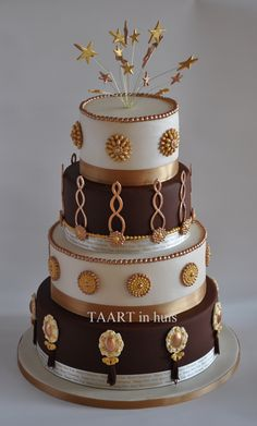 brown, white and gold cake