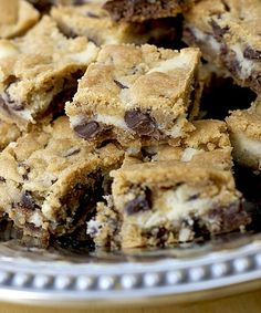 This recipe is called cookies in a cloud. It is the one my friends always request me to make. Layer a 9x13 pan with chocolate chip cookie dough. Mix an 8 oz package of cream cheese, 1/2 cup of sugar and 1 egg and layer on top of cookies. Add another cookie layer on top of the cream cheese layer. Bake in the oven at 350 until the cookies are done.