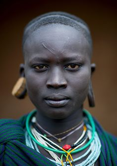 Miss Nachure, Surma Suri woman face with scarifications - Kibish Ethiopia  © Eric Lafforgue