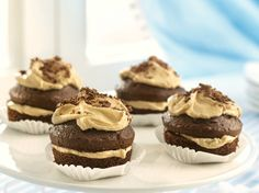 A layer of penuche creates frosted chocolate cupcakes reminiscent of a delicious mini layered cake.