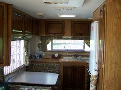camper remodel - reupholstered bench seats, painted counter tops for fifth wheel travel trailer