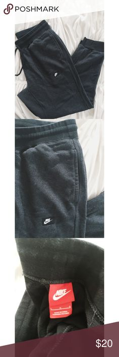 Nike Joggers Sweat Pants Nike Joggers Sweat Pants.  Women's size large.  Dark grey in color with black trim.  Great condition.  No pilling. Nike Pants Track Pants & Joggers