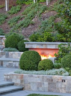 Outdoor hearth w/ tiered walls and seating