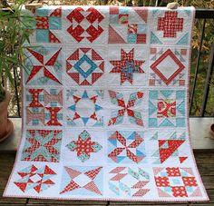 summer sampler quilt hanging