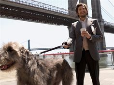 Guillaume Canet, a cup of coffee and an Irish wolf hound. Perfection.