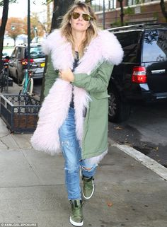 The day after the night before: Heidi Klum looked back to normal in New York on Tuesday fo...