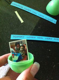 """Instead of candy inside an egg, hot glue a photo inside. Close egg with other half and glue a strip of paper around egg that says """"Mommy loves you very much!"""""""