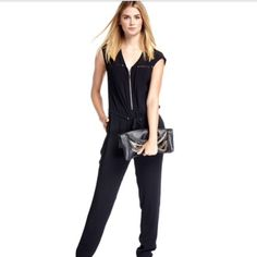 """Rebecca Taylor jumpsuit in crepe. Rebecca Taylor jumpsuit in crepe. Approx. 59.5""""L from shoulder to hem. V neckline; zip front. Cap sleeves. Mesh trim at front with stud detail. Drawstring waist. Slit pockets at hips. Straight legs. Rayon; trim: silk; lining: polyester. Dry clean. Imported. Rebecca Taylor Pants Jumpsuits & Rompers"""