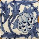 white square tile depicting blue artichoke