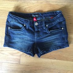 "EIGHTY EIGHT Lowrise Blue Jean Short Shorts EIGHTY EIGHT Lowrise Blue Jean Short Shorts.   Blue rami/cotton/polyester/spandex blend stretchable denim material.  Waist 27"".   Inseam length 2-1/2"".   Rise 6-1/2"".  Excellent condition. Eighty Eight Shorts Jean Shorts"