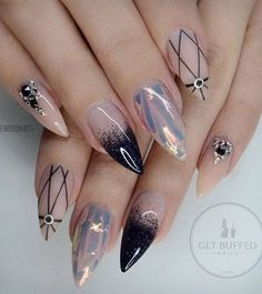 These nails remind me of the universe with the dark blue and black rhinestones on her ring finger. Black patterns can nice to emphasize the light color on your nails.: