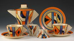 Clarice Cliff Conical shape Early Morning teaset (teapot, creamer, sugar, cups, saucers & plate) in the Diamonds pattern, w/ closed (solid) triangular handle, c. ????, handpainted enamel on glaze, ceramic, UK