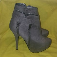 Grey Ultra Suede zipper accented bootie Grey Ultra Suede booties with double zipper accent. The color of these booties have a chameleon quality as you can see in the pictures, they look grey or taupe depending on the lighting. JustFab Shoes Ankle Boots & Booties