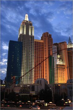 New York, New York – Resort and Casino in the evening – roller coaster in front - at the Strip - Las Vegas Boulevard - Las Vegas, Nevada, USA