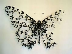 "I don't know what this is made with, bit it would lend itself well to origami. ""Mariposas con latas de cerveza Vacías"""