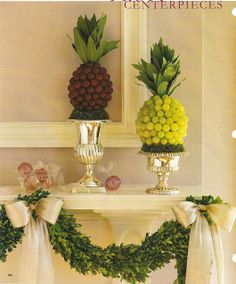 "Fruit ""pineapples"" in pretty urns, laurel leaf garland."