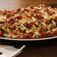 Italian Sausage Lasagna - 12	lasagna noodles, uncooked 2	Tbsp olive oil 1	(16-oz) package Johnsonville Italian Ground Sausage 1	medium onion 2	cloves garlic, chopped 1	(24-oz) jar marinara sauce 4	cups ricotta cheese 1	large egg ½	cup grated Parmesan cheese 2	cups fresh spinach, lightly packed and chopped 2	cups shredded mozzarella cheese 1	tsp dried oregano