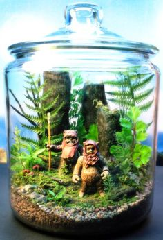 Tony Larson who imagines some highly detailed scenes in aquariums, terrariums and other glass containers.