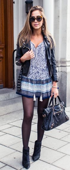 Just The Design: Kenza Zouiten is wearing a blue floral Nelly dress paired with a Kenza black leather jacket