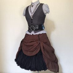 OVERNIGHT Shipping Available to most U.S. locations! Contact me with your zip code for more info.  A complete adult womens steampunk pirate costume including jewelry & accessories. Including a vintage soft nylon petticoat, a brown full skirt, a pinstriped top, a pinstriped vest, a waist belt with a chainlink buckle, and 2 necklaces.  Size XS / Small 2/4   Thanks for stopping by! www.facebook.com/pages/PassionFlowerVintage/237850299611432