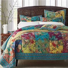 Patchwork quilt brightens the bed with tropical blooms in refreshing summer colors. Artisan-crafted quilt made pre-washed cotton for added softness.