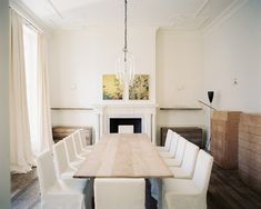 A planked wooden table adds texture to the minimally elegant dining room of the Jo Malone London headquarters, designed by Rose Uniacke.  Click to browse more ideas for decorating with natural wood, and to shop our favorite wooden finds!