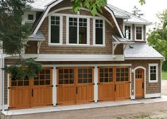 Studio Carriage Doors - Studio Sargent Carriage Doors (SL07) and the  Arched Craftsman Traditional Entry Door (ECTL05-A) on Whidbey Island, Washington (WA) by Real Carriage Door Co., Inc.