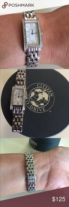 Citizen ladies watch Slightly used citizen ladies watch. Perfect condition & worn it a few times. No scratches & comes with the original box & manual. Took a few links out to fit on my wrist perfectly & I kept the links so it can put it back depend on my size of the wrist. It's a beautiful watch with white crystals in both sides of the watch. Citizen Accessories Watches